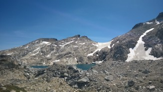 First view from the top of Aasgard at the remnants of the glacier and Isolation Lake